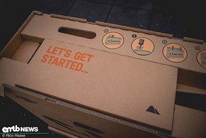 Der Karton ist geöffnet und fordert dazu auf, das E-Bike komplett auszupacken